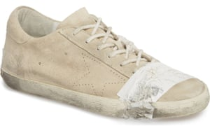 The Golden Goose sneakers have 'crumply, hold-it-all-together tape details', according to the description.