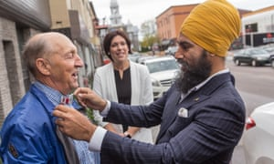 NDP leader Jagmeet Singh talks with a passerby as he visits Alma in the riding of Lac St-Jean on October 10, 2017.