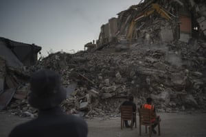 Egyptian workers remove the rubble of a building destroyed by an airstrike in Gaza City.