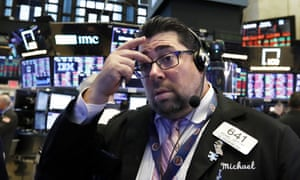 A trader at the New York Stock Exchange