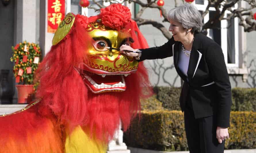 Theresa May at a cultural reception held at the British ambassador's residence in Beijing.