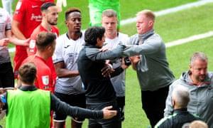 Swansea's first-team coach, Alan Tate, clashes with David Karanka, assistant coach of Birmingham