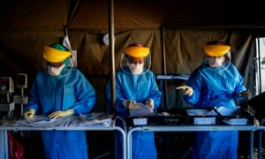Health workers at screening and testing tents set up at the Charlotte Maxeke Hospital in Johannesburg.