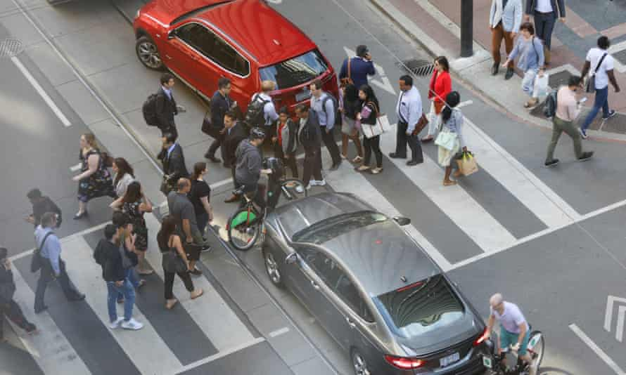 Pedestrians, cyclists and motorists navigate the complicated and confusing intersection of Bay Street and Richmond Street West in Toronto.