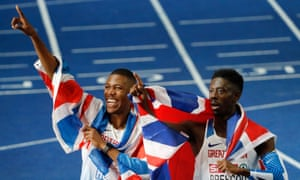 Zharnel Hughes (left) and Reece Prescod of Great Britain celebrate after placing first and second respectively in the men's 100m final at the 2018 European Championships.