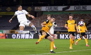 Leeds United's Raphinha in denied by Wolverhampton Wanderers' Conor Coady.