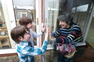 Knutsford, EnglandBen and Isaac (left), talk to their grandmother Sue through a window at her home in Cheshire, while she continues to follow coronavirus lockdown rules. It has been almost year since she has had physical contact with her grandchildren