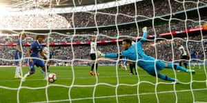 Hugo Lloris stretches but isn't close to stopping Hazard's shot.