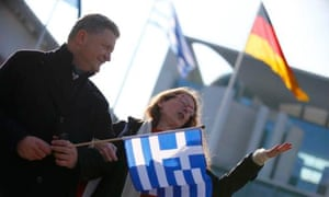 REFILE - CORRECTING HEADLINE People hold German and Greek national flags duirng a rally for 'good German Greek cooperation' in front of the Chancellery in Berlin March 23, 2015. Greek Prime Minister Alexis Tsipras will make his first official visit to Germany and is due to meet with German Chancellor Angela Merkel later on Monday. REUTERS/Hannibal Hanschke