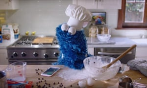 An advert for Apple's digital assistant Siri features Sesame Street's Cookie Monster.
