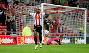 Jermain Defoe celebrates scoring Sunderland's second goal against Extere City in his side's Capital One Cup second-round victory.