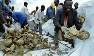 Rwandans place the skulls of several hundred Tutsi civilians into bags after a memorial for approximately 12,000 Tutsi massacred by Hutu militia in and around the western town of Kaduha.