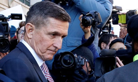 The former US national security adviser Michael Flynn leaves after his sentencing was delayed at US district court in Washington on 18 December 2018.