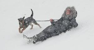 A woman and her dog enjoy the snow near Dublin