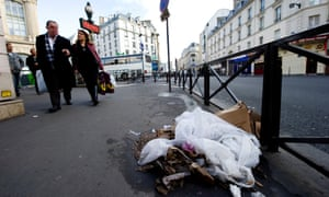 Pedestrians walk past rubbish on the pavement near Gare du nord train station, Paris.