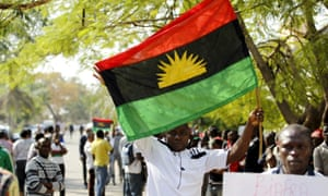 A man holds a Biafran flag during a rally in support of Nnamdi Kanu, the head of Radio Biafra.