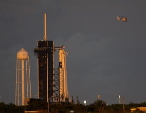 A SpaceX Falcon 9 rocket carrying the company's Crew Dragon spacecraft prepares to launch.