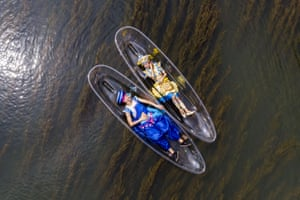 Performers lie on transparent boats as they rehearse for a show on the Lijiang River in Guangxi Zhuang