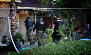 Immigration and Customs Enforcement agents conduct a raid in Riverside, California.