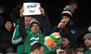 Republic of Ireland fans hold up a banner reading 'O'Neill out' in Aarhus.