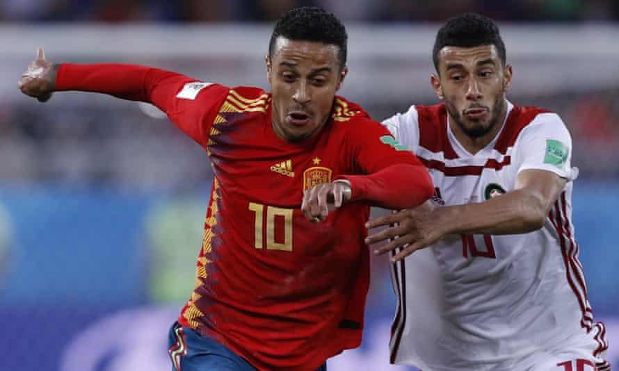 Thiago looks to hold off Morocco's Younes Belhanda