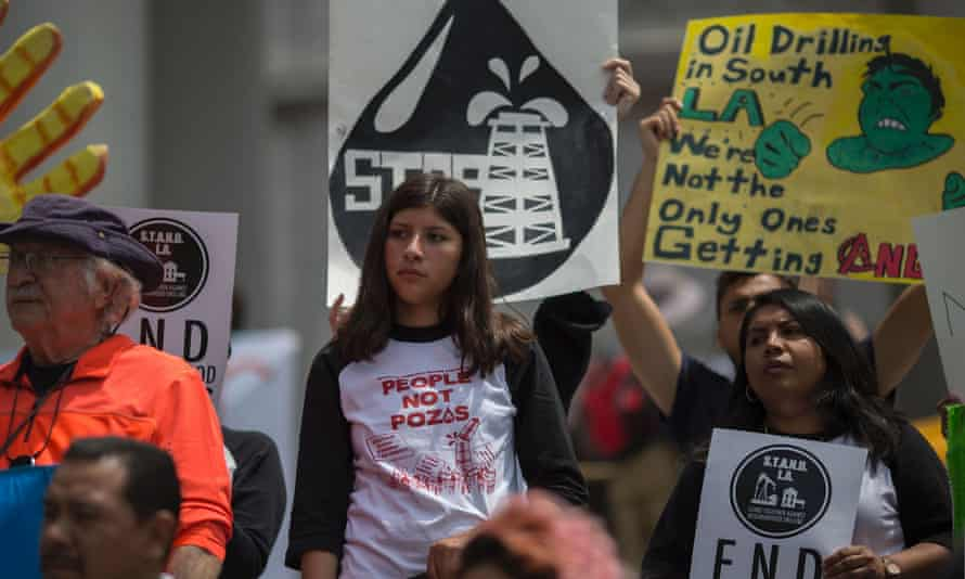 Activists oppose oil wells in immigrant neighborhoods during a protest in Los Angeles on Saturday.