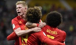 Kevin De Bruyne (left) celebrates Belgium's crucial equaliser against Japan.