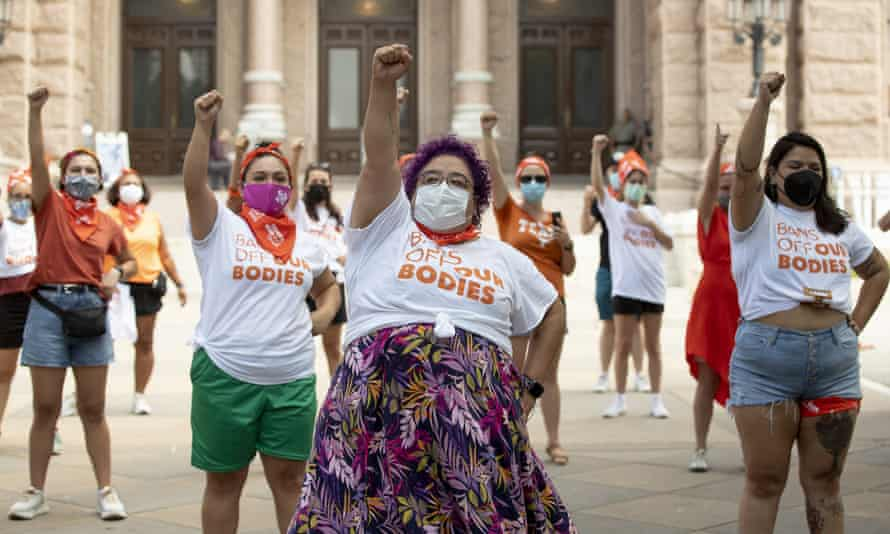 Protesters campaign against the six-week abortion ban at the Capitol in Austin, Texas.