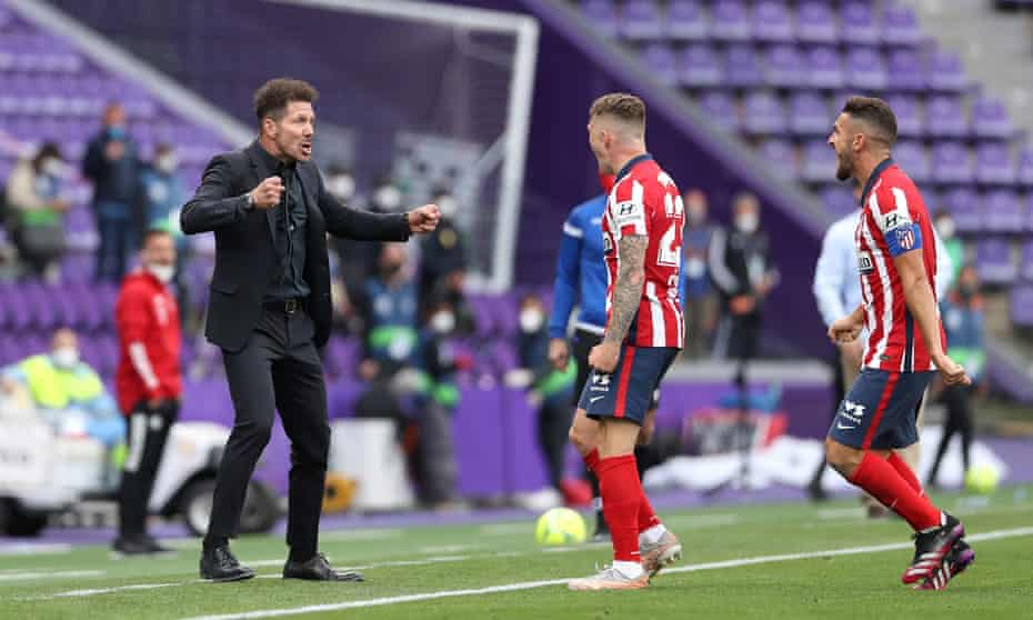 Diego Simeone and Kieran Trippier celebrate together as Atlético's title is confirmed at Vallodolid.