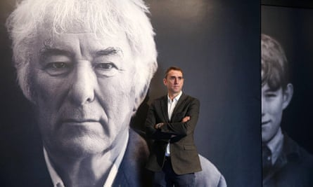 HomePlace manager Brian McCormick, Heaney's nephew, in front of the poet's photo at the entrance to the centre.