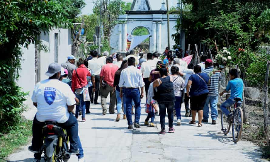 Inhabitants of the Telixtac indigenous community move the remains of a person who died after ingesting allegedly adulterated alcohol, in the municipality of Axochiapan in the state of Morelos, Mexico, on Tuesday.