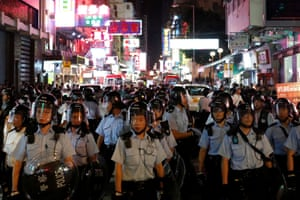 Hong Kong, China Riot police stand guard during a march against the extradition bill in Hong Kong's tourist district of Mongkok
