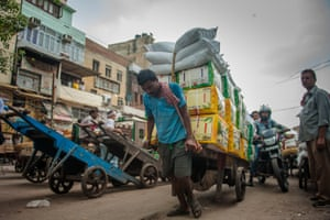 New Dehli, IndiaDaily life within the walled city relies on workers and rickshaw pullers ferrying passengers and carrying goods from mini-factories to shopkeepers.Rickshaw pullers ferry passengers and workers carry goods from factories to shopkeepers in Delhi