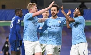 Kevin De Bruyne of Manchester City (L) celebrates after scoring.