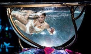 Fish bowl courtship … Miranda takes a dip in Amaluna.