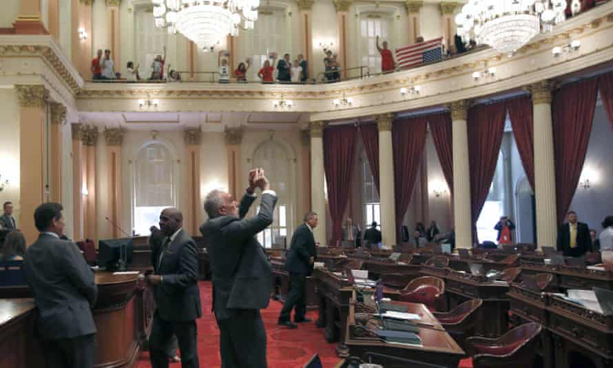 The state senator Mike Morrell takes a photo of demonstrators in the senate gallery on Wednesday.