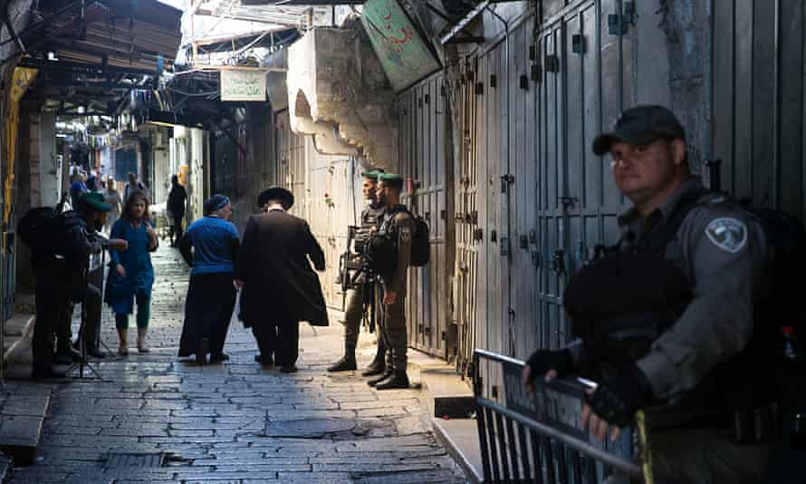 Israeli border police stand guard in the lanes of the Muslim Quarter of Jerusalem's Old City, captured 50 years ago in 1967 during the six-day war