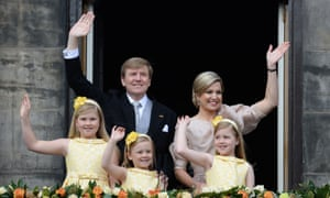 King Willem-Alexander, his wife, Queen Maxima, and their children wave to crowds in Amsterdam in 2013 following the abdication of Queen Beatrix.