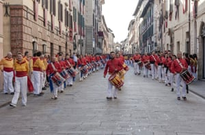 The ceraioli parade with drums on the morning before the Corsa dei Ceri (Race of the Candles)