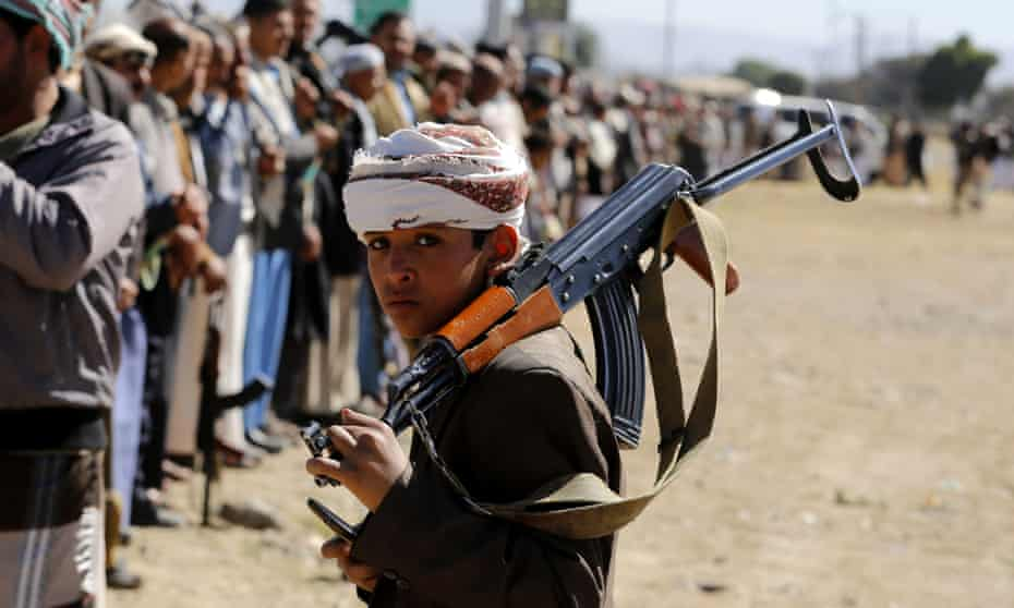 A child supporter of Houthi rebels carries a weapon during a gathering to show support in Sana'a, Yemen