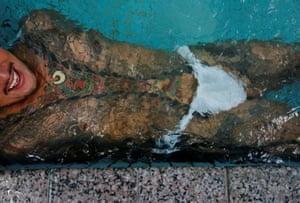 Restaurant owner Hiroshi Sugiyama shows off his intricate tattoos at a public bath.