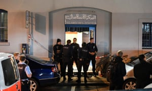 Policemen secure the area in front of the Islamic centre after a shooting in Zurich.
