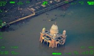 Buildings in Palu remain inundated.