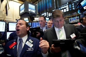 Specialist trader Michael Pistillo yells out a price for traders on the floor of the New York stock exchange today.