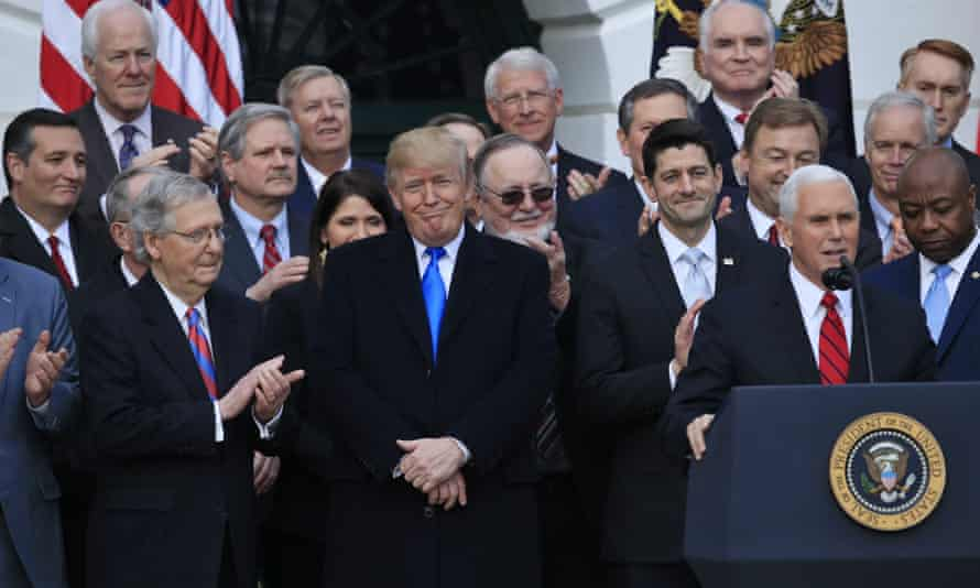 Republican lawmakers celebrate the passage of their tax bill at the White House with Donald Trump and Mike Pence on 20 December 2017.