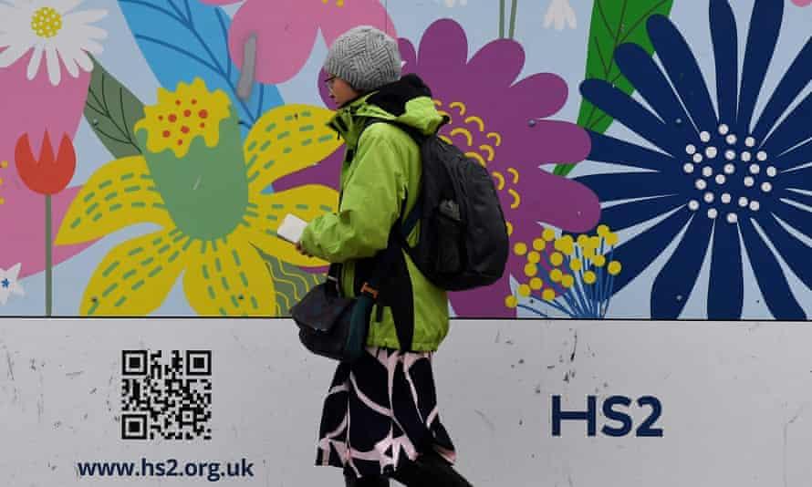 A pedestrian walks past the HS2 construction site in Euston, London.