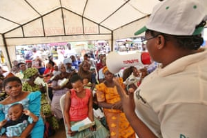 Oduola Tayo, regional clinic officer, speaks women about family planning methods during a Planned Parenthood Federation of Nigeria (PPFN) outreach programme