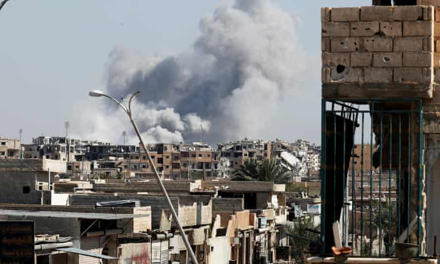 Smoke rises after a coalition air strike in Raqqa, Syria