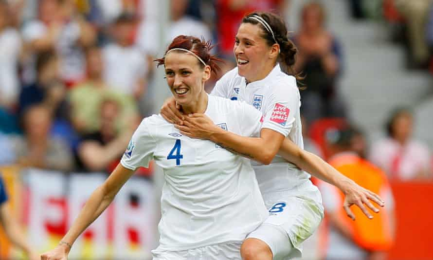 Jill Scott with Fara Williams, the only player with more England caps, after scoring at the 2011 World Cup.