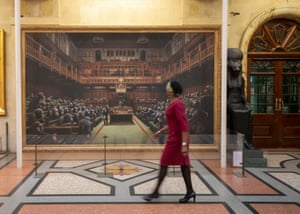 Bristol, EnglandA passer-by views the painting 'Devolved Parliament' by the graffiti artist Banksy, which is going on show at Bristol Museum.